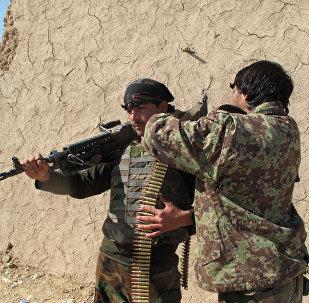 Soldados afegãos em uma pausa entre combates, em 21 de dezembro