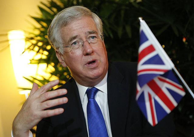 O ministro da Defesa do Reino Unido, Michael Fallon, durante uma conferência na Cingapura