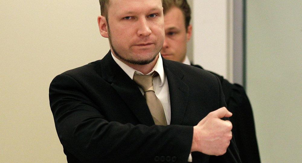 Accused Norwegian Anders Behring Breivik gestures as he arrives at the courtroom, in Oslo, Norway