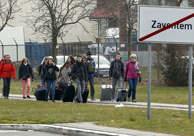 People leave the scene of explosions at Zaventem airport near Brussels, Belgium, March 22, 2016