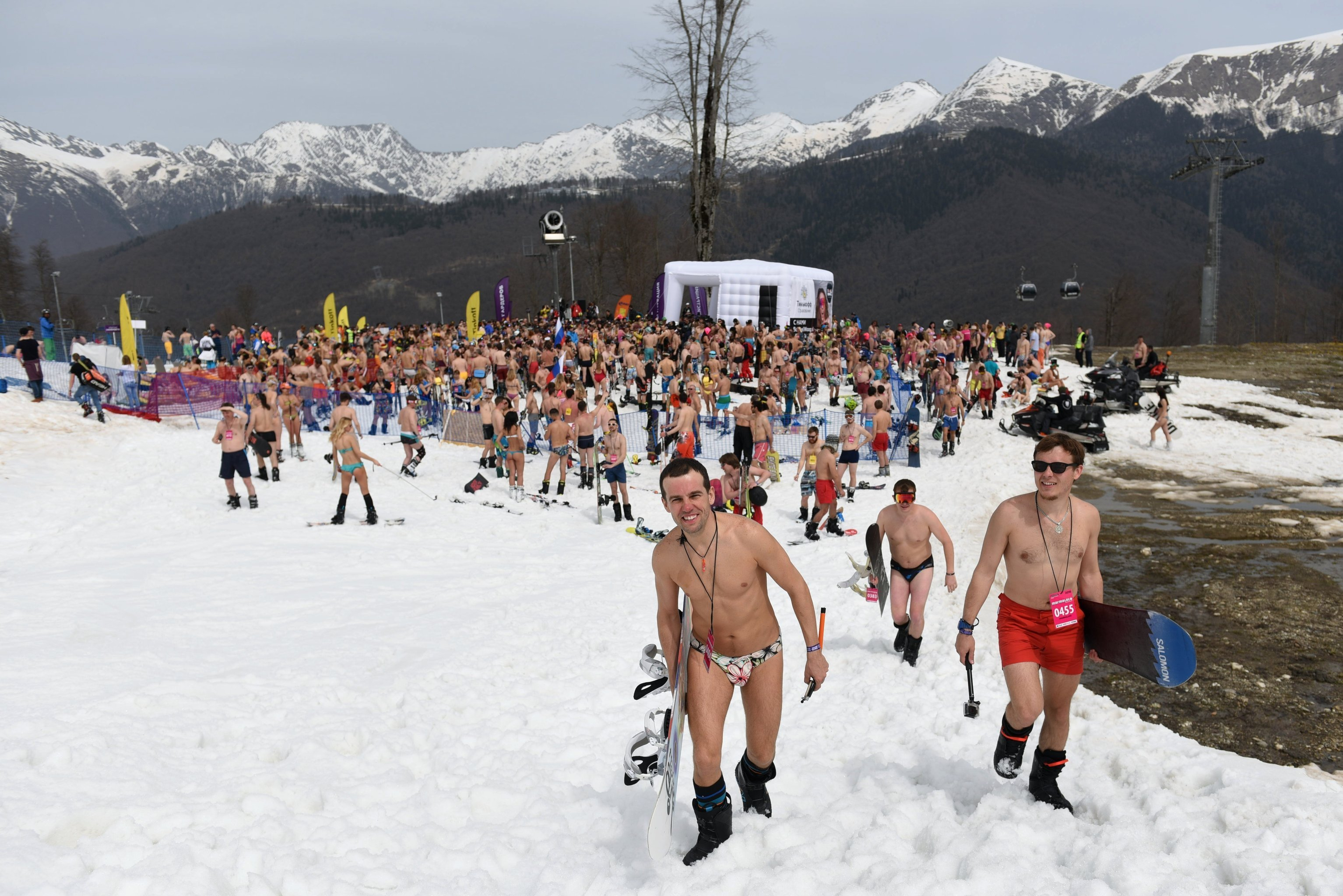 Participants of bikini downhill skiing at the BoogelWoogel festival on the slope of the Roza Khutor alpine resort in Sochi National Park. The event aims to set a Guinness world record