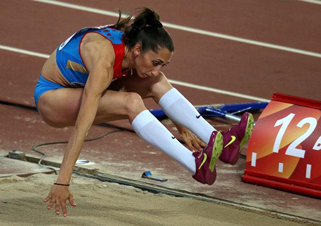 Na foto: a russa Ekaterina Koneva durante prova de qualificação de salto triplo no campeonato mundial de atletismo em 2015, em Pequim
