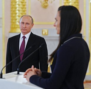 July 27, 2016. Russian President Vladimir Putin and two-time Olympic champion Yelena Isinbayeva during the former's meeting with the national Olympic team before its sendoff to the 2016 Summer Olympics in Rio de Janeiro. The Kremlin.