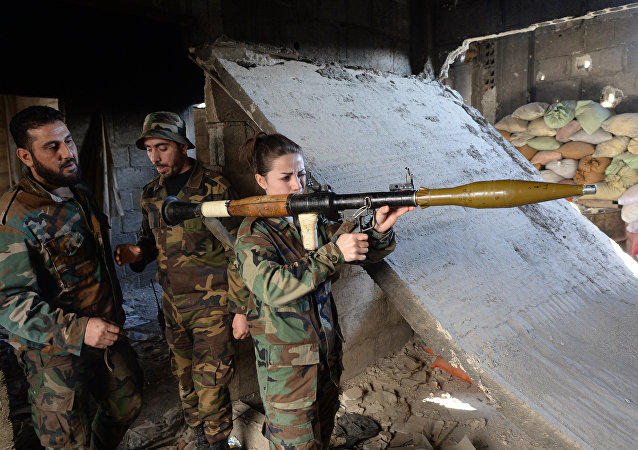 Soldiers of the Syrian Army in Darayya, a Damascus suburb