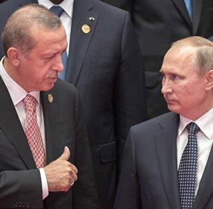 Vladimir Putin e Recep Tayyip Erdogan durante sessão de fotos dos líderes do G20 em Hangzhou, na China