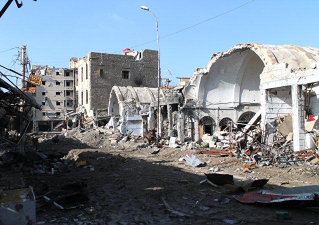 PrédioPrédios destruidos após ataque aéreo da coalizão internacional liderada pelos EUA na Síria (foto de arquivo)