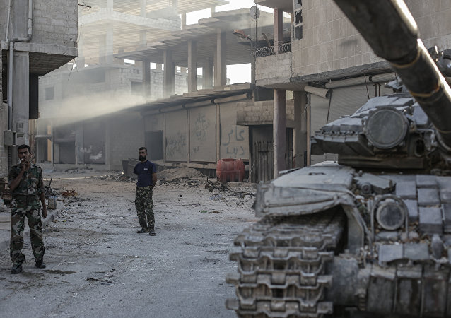 Soldados sírios na cidade de Ghouta, perto de Damasco (arquivo)