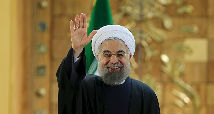 Iranian President Hassan Rouhani waves during a news conference in Tehran, Iran January 17, 2016.