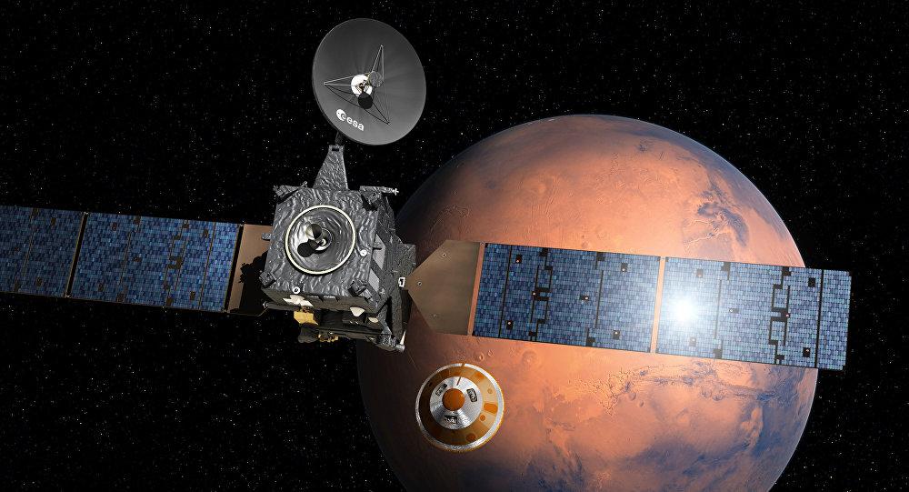A impressão de um artista da separação do módulo, chamado Schiaparelli, indo a Marte