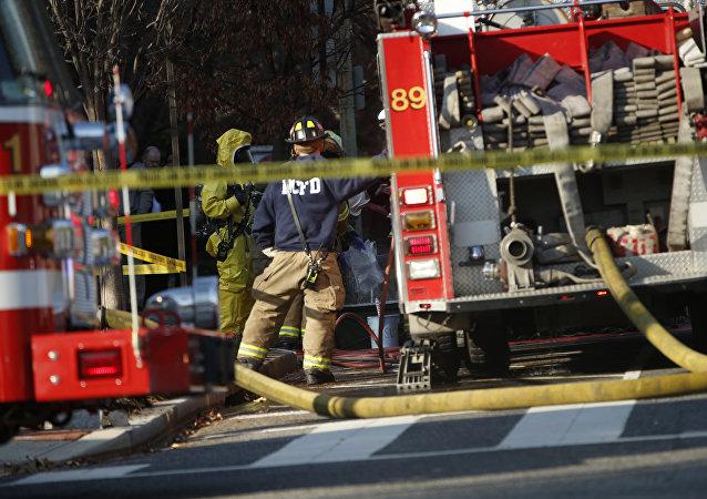 Bombeiros e a polícia norte-americana (Foto de arquivo)