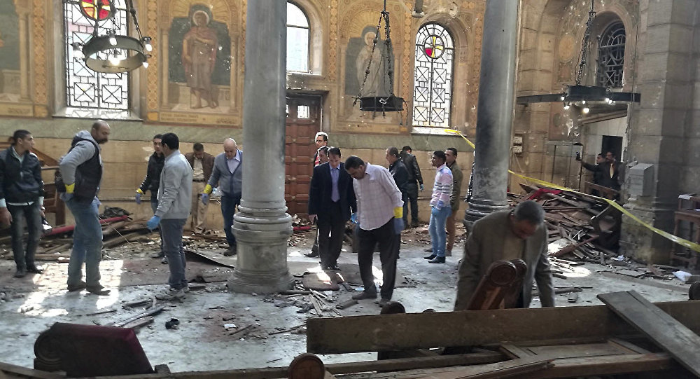 Egyptian security forces examine the scene inside St. Mark Cathedral in central Cairo, following a bombing, Sunday, Dec. 11, 2016