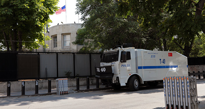 A Turkish riot police van is stationed outside the US Embassy as supporters of President Recep Tayyip Erdogan were expected to come to protest, in Ankara, Turkey, Monday, July 18, 2016