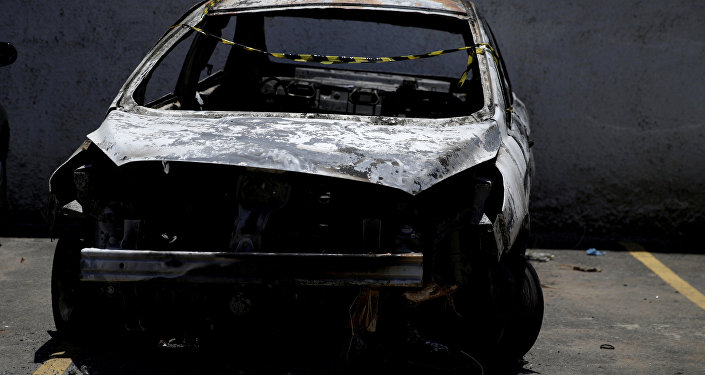 Carro quemaido do embaixador grego morto no Brasil