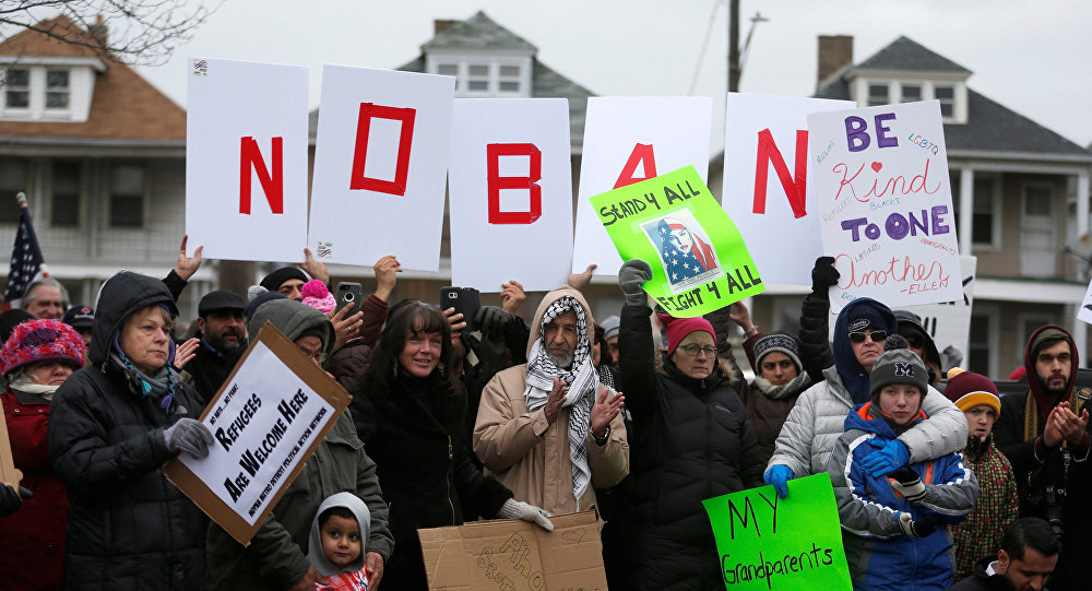 Several hundred people rally against a temporary travel ban signed by U.S. President Donald Trump in an executive order during a protest in Hamtramck, Michigan, U.S., January 29, 2017
