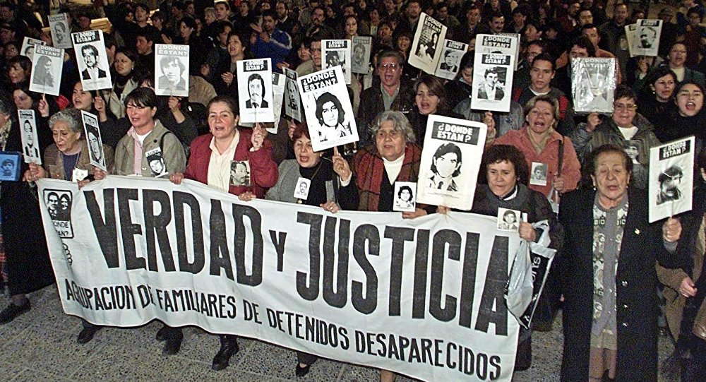 Relatives of victims of the Pinochet regime and members of human right groups (File)