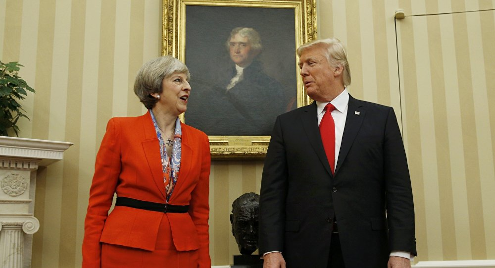 U.S. President Donald Trump speaks with British Prime Minister Theresa May in the Oval Office of the White House in Washington January 27, 201