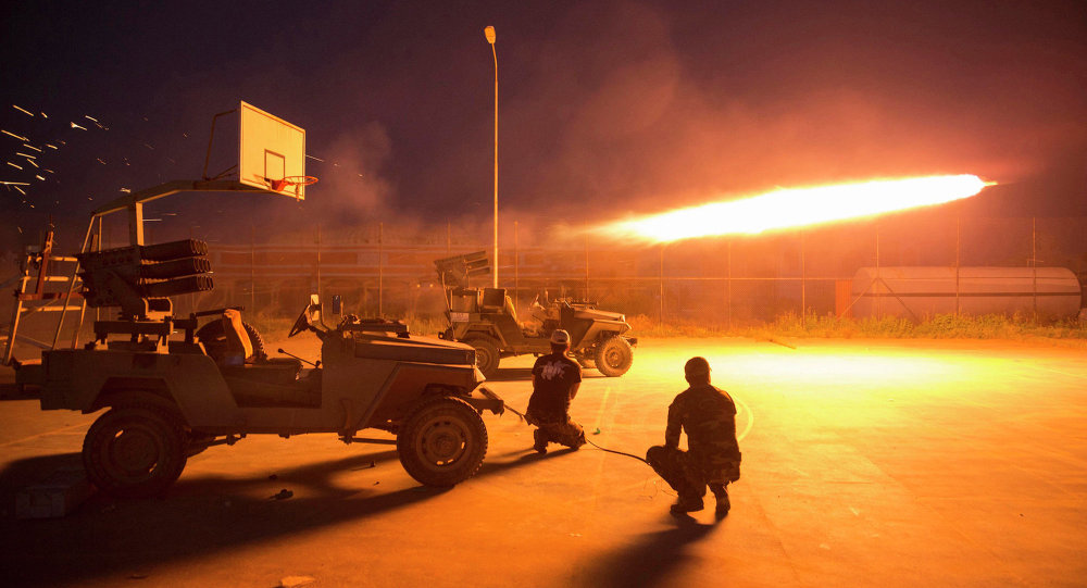 Shi'ite fighters fire a rocket during clashes with Islamic State militants in Salahuddin province March 1, 2015