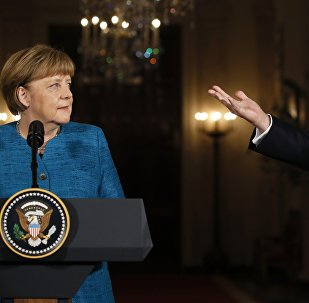 Trump e Merkel em coletiva realizada em Washington