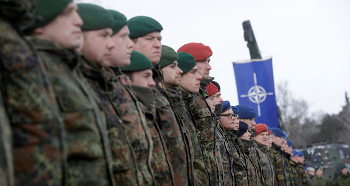 German soldiers attend a ceremony to welcome the German battalion being deployed to Lithuania as part of NATO deterrence measures against Russia in Rukla, Lithuania February 7, 2017