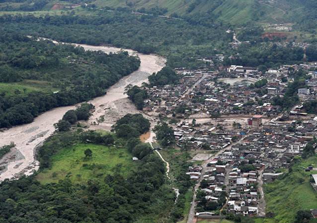 An aerial view shows a flooded area after heavy rains caused several rivers to overflow, pushing sediment and rocks into buildings and roads in Mocoa, Colombia