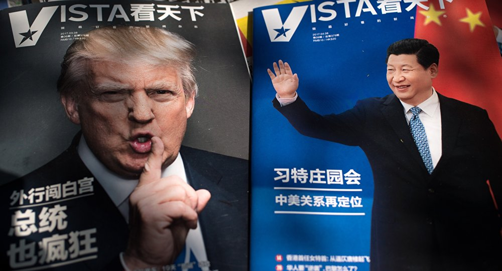 Retratos dos presidentes dos EUA e da China em revistas chinesas (foto de arquivo)