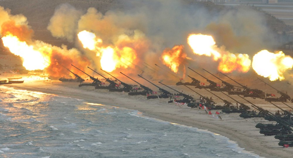 Artillery pieces are seen being fired during a military drill at an unknown location, in this undated photo released by North Korea's Korean Central News Agency (KCNA) on March 25, 2016