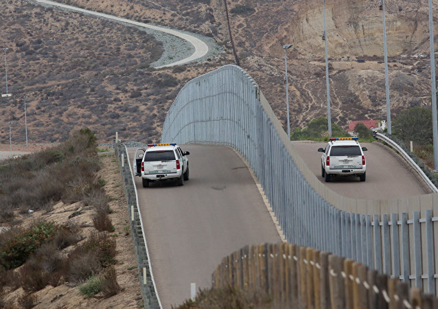 Border Patrol agents patrol the United States-Mexico Border wall during Opening the Door Of Hope/Abriendo La Puerta De La Esparana at Friendship Park in San Ysidro, California on Saturday, November 19, 2016