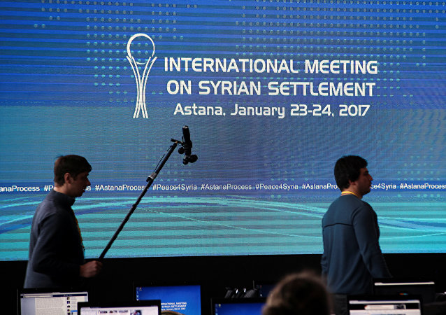 Reporters walk in the media center set for Syria peace talks, in Astana, Kazakhstan, January 23, 2017.