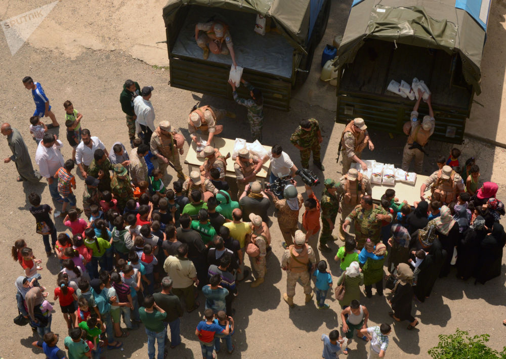 Ajuda humanitária da Rússia chega a um campo de refugiados na província síria de Latakia