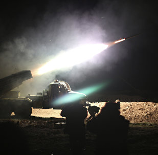 Soldiers from the Syrian army fire a rocket at Islamic State group positions in the province of Raqqa, Syria