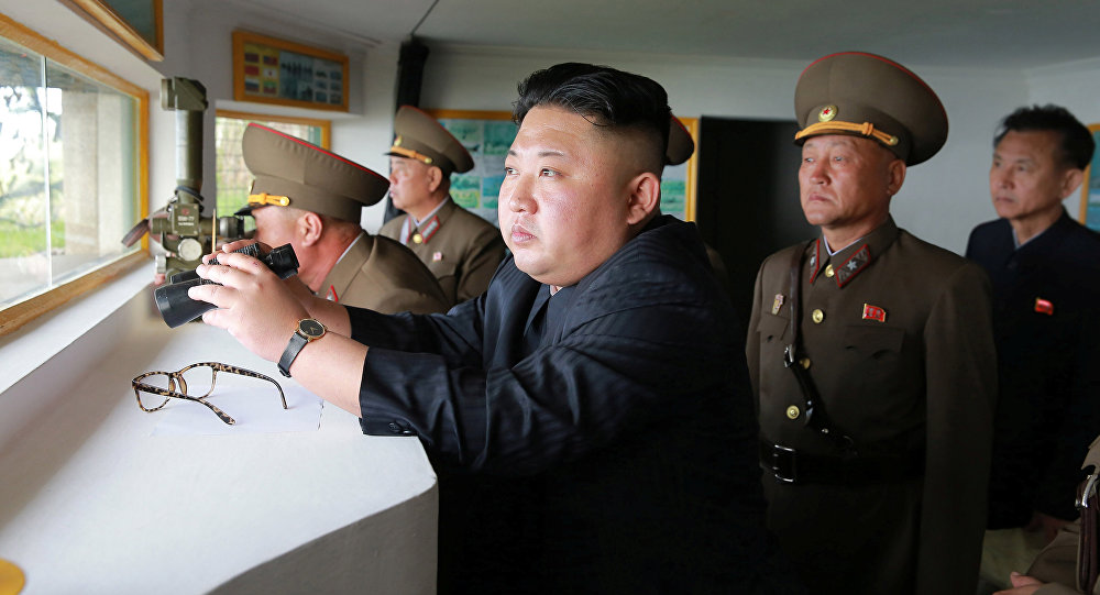 North Korean leader Kim Jong Un inspects the defence detachment on Jangjae Islet and the Hero Defence Detachment on Mu Islet located in the southernmost part of the waters off the southwest front, in this undated photo released by North Korea's Korean Central News Agency (KCNA) on May 5, 2017
