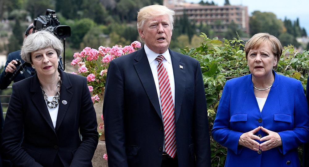 A primeira-ministra britânica, Theresa May, o presidente dos EUA, Donald Trump, e a chanceler alemã, Angela Merkel, durante a Cúpula do G7 em Taormina, Sicília, Itália, 26 de maio de 2017.