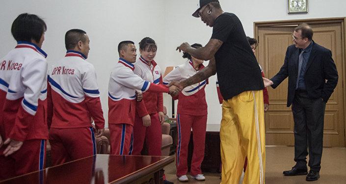 Cumprimentando os atletas locais