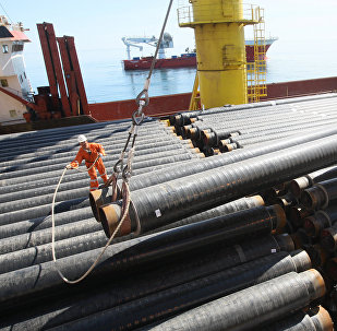 Placing gas pipes on the deck pipelayer