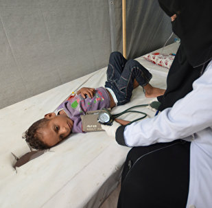 A nurse attends to a boy infected with cholera at a hospital in the Red Sea port city of Hodeidah, Yemen May 14, 2017