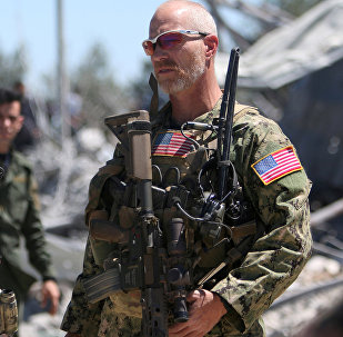 US forces are seen at the Kurdish People's Protection Units (YPG) headquarters after it was hit by Turkish airstrikes in Mount Karachok near Malikiya, Syria April 25, 2017.