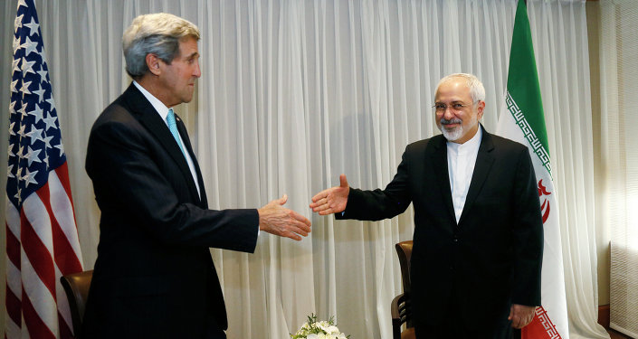US Secretary of State John Kerry, left, shakes hands with Iranian Foreign Minister Mohammad Javad Zarif