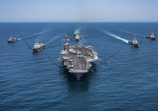 In this image released by the U.S. Navy, the aircraft carrier USS Carl Vinson, flanked by South Korean destroyers, from left, Yang Manchun and Sejong the Great, and the U.S.Navy's Wayne E. Meyer and USS Michael Murphy, transit the western Pacific Ocean Wednesday, May 3, 2017.