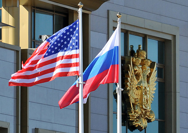This photo taken on May 7, 2013 shows Russian and the US flags running up as the US Secretary of State arrives at Moscow Vnukovo Airport