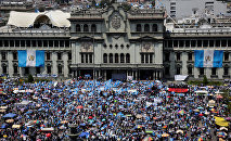 Anti-government protesters participate in a march in Guatemala City, Guatemala September 20, 2017