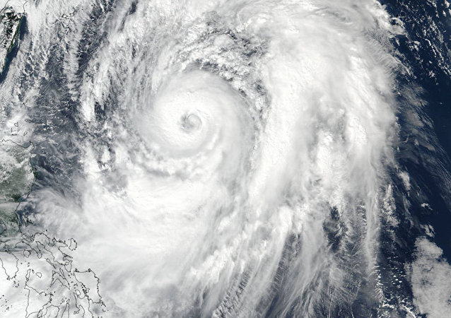 NASA-NOAA Suomi NPP satellite visible light image of Typhoon Lan on October 20 at 12:30 a.m. EDT.