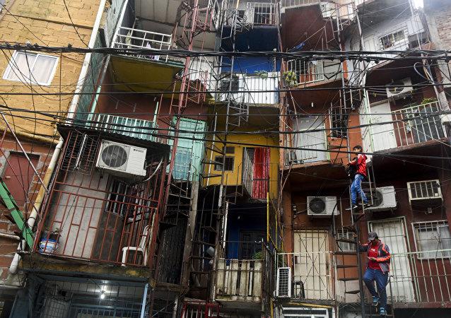 Habitantes da Villa 31, bairro de Buenos Aires, Argentina
