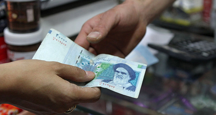 20000 rial banknote bearing a portrait of Iran's late founder of islamic Republic Ayatollah Ruhollah Khomeini