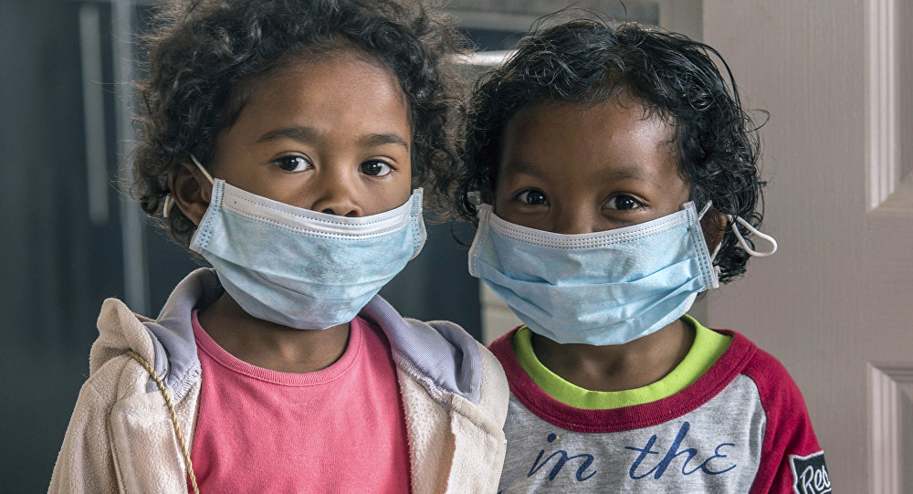 In this Tuesday, Oct. 3, 2017 file photo, children wear face masks at a school in Antananarivo, Madagascar.