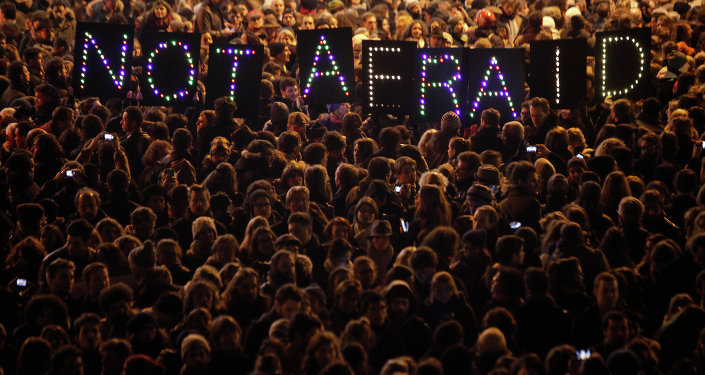 People gather in solidarity of the victims of a terror attack against a satirical newspaper, in Paris, Wednesday, Jan. 7, 2015.