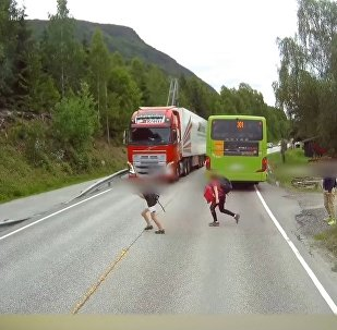 Kid Barely Avoids Getting Run Over by Trailer in Norway