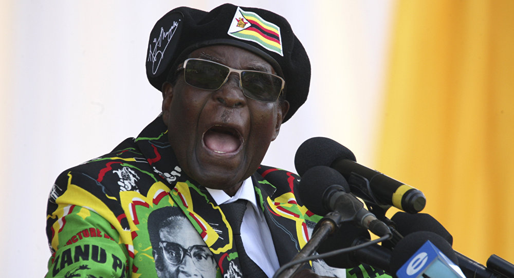 This file photo taken on November 04, 2017 shows Zimbabwe's President Robert Mugabe delivering a speech during the Zimbabwe ruling party Zimbabwe African National Union- Patriotic Front (Zanu PF) youth interface Rally in Bulawayo