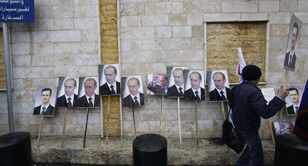 Photos of Syrian President Bashar Assad and Russian President Vladimir Putin are propped against a wall during a pro-Syrian government protest in front of the Russian Embassy in Damascus, Syria. (File)